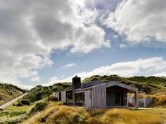 Perfectly located chalet, well camouflaged amongst the dunes in the Danish countryside. Covered Decks, Space Architecture, The Dunes, Countryside, Seaside, Cottage, Clouds, Cabin, House Styles