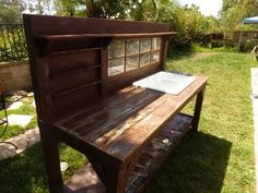 Potting bench with sink, shelves, & old window
