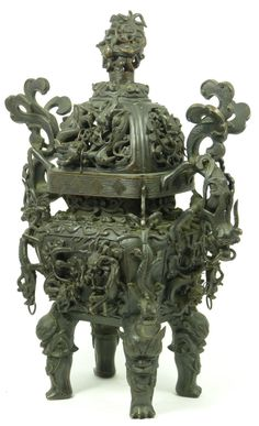 Antique Chinese bronze censor having dragon handles and intricate raised dragon designs throughout body. Has figural foo dog head feet. Holds impressed six character Qianlong dynasty mark to bottom.