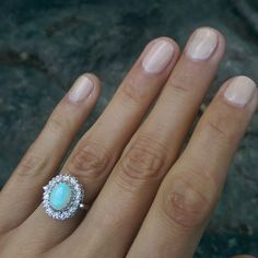 Vintage Romany 14K White Gold Opal and Diamond Halo Ring .. I'm liking the opal surrounded by diamonds