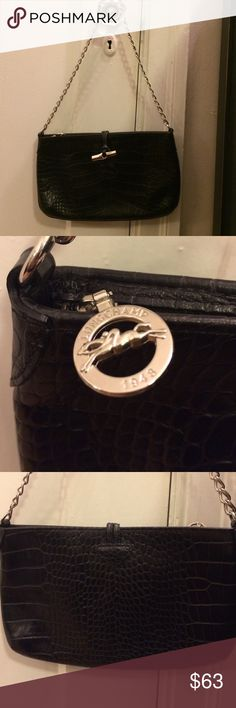 Longchamp Black Leather Handbag Authentic mint condition leather handbag. 11 inches wide, 6.75 inches height. Silver buckle and chain strap. No signs of wear. Used a few times. Fits nicely on shoulder. Great for night out. Longchamp Bags Mini Bags