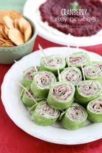 Cranberry Turkey Pinwheels have layers of cream cheese, spicy-sweet cranberry salsa, and thinly sliced turkey all rolled up in a spinach tortilla for a delicious party appetizer!