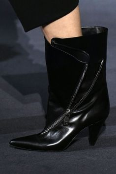 For the second season in a row, Waight Keller made a strong bid for boot of the season. Almost every look including chubby fake-fur coats and glimmering evening column dresses were accessorised with eighties-inflected cone heeled ankle boot. Not only can you wear these boots with everything but they can also be worn two different ways - either wide and proud of the leg or folded over and zipped up. Put them on your wish list now.