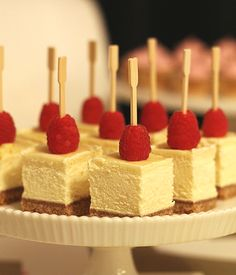 classic cheesecake cut into two-bite portions and topped with a fresh raspberry