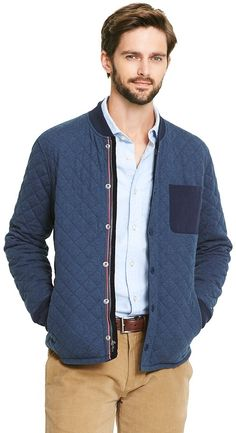 Tommy Hilfiger men's jacket. Quilted cotton brings this sporty number into the now. Dress it up or down with an Oxford, tie and dark jeans. • 100% cotton. • Covered zip front, side pockets, ribbed trims, microflag on cuff. • Machine washable. • Imported. Brand: Tommy Hilfiger Retailer: Tommy-Hilfiger