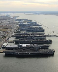 In this image provided by the U.S. Navy shows aircraft carriers from left: USS Dwight D. Eisenhower, USS George H.W. Bush, USS Enterprise, USS Harry S. Truman, and USS Abraham Lincoln in port at Naval Station Norfolk, Va., the world's largest naval station Thursday Dec. 20, 2012. (AP Photo/US Navy/ Specialist 2nd Class Ernest R. Scott) I miss VA :/