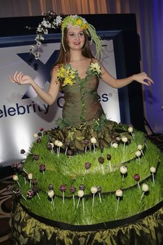 The walk-around event at Fontainebleau Miami Beach featured a roving performer wearing a dress strewn with cake pops. Photo: Alexander Tamargo/Getty Images for Food Network SoBe Wine & Food Festival