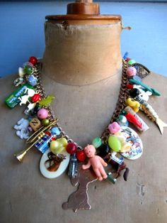 This reminds me of the these bright neon charm necklaces we used to wear when I was in about the 6th grade!  They were all the rage!
