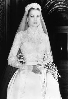 Grace Kelly in Monaco at her wedding to Prince Rainier III. A long-sleeved wedding dress designed by film costume, 1956.