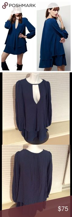 Free People Blue Beck Double Layer Ruffle Dress XS In a shapeless swingy body this two tiered long sleeve dress was made in philadelphia. Featurs a plunging neckline, rayon, dry clean *Measured Flat* Across shoulders: 16in Sleeve length: 26in Top to bottom hem: 30in Free People Dresses Midi