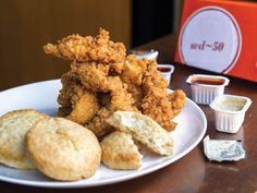 Wylie Dufresne's shortening-based biscuits, created as an homage to Popeyes', boast a delicate, pillowy interior surrounded by a gently crisp crust. Serve them alongside these Popeyes-style chicken tenders. Chicken And Biscuits, Buttermilk Chicken, Buttermilk Biscuits, Popeyes Fried Chicken, Fried Chicken Tenders, Chicken Brine, Breaded Chicken, Chicken Tender Recipes, Fried Chicken Recipes