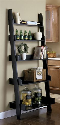 Ladder shelves can be used to decorate the home, showcase collectibles and for e. Living Room Remodel Before and After - Diy Home Decor Crafts Sweet Home, Diy Casa, Diy Home, Ladder Bookcase, Black Ladder Shelf, Ladder Racks, Leaning Bookshelf, Leaning Shelf, Bookshelf Styling