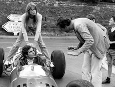 Scene from the backstage of Grand Prix (1966), with Lisa (Françoise Hardy) catching a lift on Nino Barlini's (Antonio Sabato) Ferrari