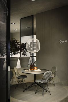 The renovated Cesar flagship store in #Milano - #Spokes lamp by #Foscarini - Photo © Andrea Ferrari