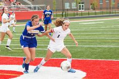 Gilbert's Olivia Stearns tries to drive past Humboldt's Emily Schaffer during the Tigers' 6-0 victory in a Class 1A regional semifinal on Friday at Gilbert. Photo by Debbie Gray/Special to the Tribune http://amestrib.com/sports/girls-soccer-tigers-charge-regional-finals