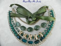 Green Lucite Bead Ribbon Tie 5 Strand Multi Chain Necklace; Handmade. Creates that unusual, striking piece that will completely transform any outfit. Add a touch of pizazz to your fashionable wardrobe with this amazing Green Lucite Bead Necklace with multi chains ending with a green ribbon. $69.48, IBHandmade