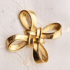 Vintage Signed Trifari Brushed Gold Tone Double Knot Brooch. $22.00, via Etsy.