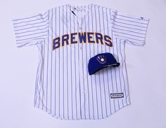 Get this look at the #Brewers Team Store:  Replica Jersey- $109.00 Royal Ball and Glove Hat- $42.00