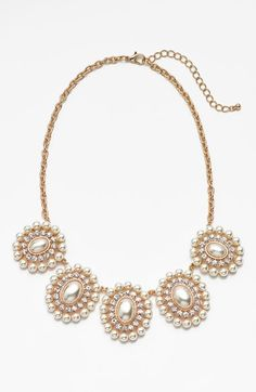 Free shipping and returns on BP. Pearl Cluster Statement Necklace (Juniors) at Nordstrom.com. Brooch-inspired faux-pearl stations are encircled with dazzling, light-reflecting crystals and tiny faux pearls for a striking statement necklace with lovely symmetry.
