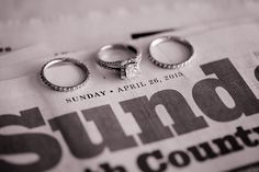 Paradise Falls Bride and Groom Wedding Rings, wedding ring photo on newspaper to show date