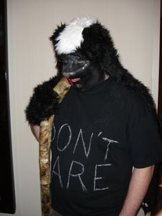 Honey Badger costume!!!! Ha! Complete with snake. Hilarious.