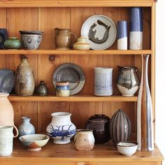 new and vintage pottery on the shelves at Coveted Home shop