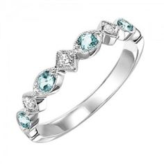 white gold diamond and blue topaz birthstone ring. The perfect December birthstone ring or mothers ring, this 10 karat white gold band has round blue topaz Aquamarine Birthstone Ring, Amethyst And Diamond Ring, Diamond Wedding Rings, Diamond Bands, Emerald Diamond, Pink Sapphire, Wedding Bands, Aquamarine Rings, Topaz Ring