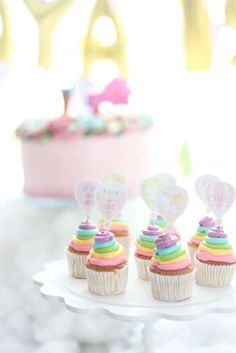 Hot air balloon birthday party rainbow cupcakes! See more party planning ideas at CatchMyParty.com!