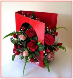 """""""SWEET GREETINGS""""  Who could resist this tempting combination of chocolate and eye appeal? Instead of words, this Greeting Card is full of chocolate rosebuds (Hershey Kisses) and silk flowers, sure to capture her heart."""