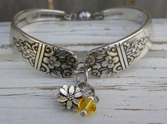 Spoon handle bracelet - flower charm - yellow crystal bead - silver vintage spoon handles - size 6 1/2 - magnetic clasp - rustic - upcycled