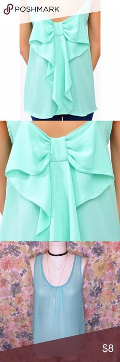 Chiffon Sheer Bow Back Tank In great condition! Color is most like cover stock photo..mint/turquoise. My camera couldn't pick up the correct color for some reason! Flowy, sheer, no stretch. Size small  Laying Flat: 18 in bust 25 in length front 29 in length back  100% polyester Jella Couture Tops Tank Tops