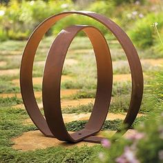 Put an inspired finishing touch on your garden space with a work of adaptable art, using our sleek Orb Garden Sculpture. The two concentric spheres are hinged at the bottom, so you can pivot the inner circle for the exact look you want-and change the p Outdoor Sculpture, Sculpture Art, Outdoor Statues, Yard Sculptures, Metal Garden Sculptures, Industrial Sculptures, Metal Garden Art, Metal Art, Plantation