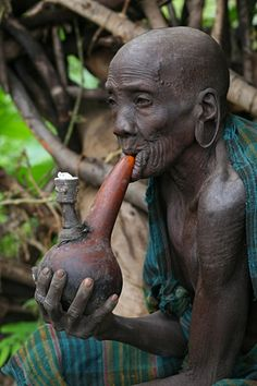 Africa |  An old Suri woman smoking from a calabash pipe | © Lars-Gunnar Svärd