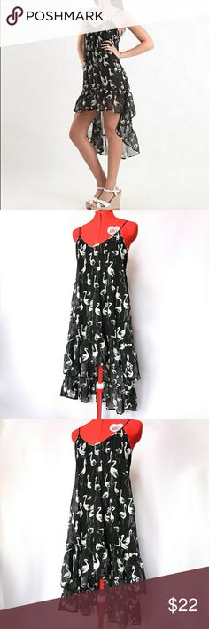 Billabong Pink Flamingo Dress, Hi Low Dress Cute flowing hi low dress from billabong with black and white pink flamingo pattern. Super cute!!! Size small Billabong Dresses High Low