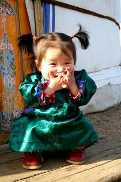 Another cute little Mongolian girl, could be one of the twins. I found so many photos of little Mongolia girls and they are all so cute!
