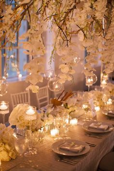 Like the hanging orchids and tea lights.  Elaborate Wedding Flower Inspiration