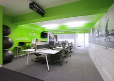 Open plan office with Fluorescence Green wall! #openplanoffice Cubicles.com
