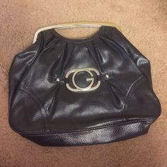 """Black leather handbag Guess handbag with silver hardware. Metal handles and magnetic closure. 12""""x 14"""" ... Very sophisticated look!  Guess Bags Clutches & Wristlets"""