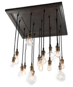 Salvaged barn tin repurposed into chandelier with various edison bulbs, Unique Industrial chic lighting, Urban Rustic design, reclaimed tin