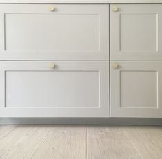 Kitchen detail: ENSIÖ doors in Feather Grey with PARASOL handles in brass. Built on IKEA cabinets. www.helsingo.com