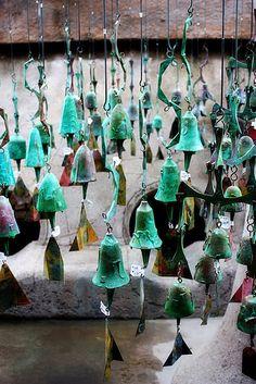 aqua bells hanging from the mesquites