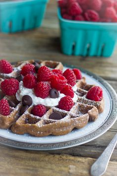 Not too sweet chocolate waffles with fresh raspberries and whipped cream!