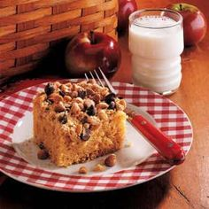 """Peanut Crunch Cake Recipe -""""Here's a recipe that dresses up a plain old box cake mix,"""" says Sue Smith of Norwalk, Connecticut. """"Peanut butter and chocolate chips add fun, yummy flavor to this yellow cake."""" Cake Mix Recipes, Dessert Recipes, Yummy Recipes, Delicious Desserts, Yummy Food, Crunch Cake, Vegetarian Cake, Box Cake Mix, Desert Recipes"""