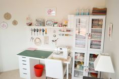 """From """"Down Grapevine Lane,"""" a lovely sewing room fit into a guest room. More pics and details at the source."""