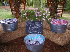 I love the way this was set-up using the wash tubs for ice and drinks is always good.  Using the Mason Jars for pickups and having the colors separate really makes a bold look! Winding Creek Farm and Wedding Barn in Hamptonville, NC