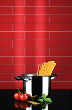 Glass tiles are an effective splashback, heat resistant to 600 degrees celcius.
