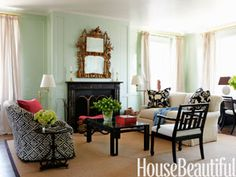 """Designer Todd Klein chose a light, cool green. """"If you think of a house as having seasons, the living room is spring,"""" Klein says. Walls are Vreeland Mint and trim is White, both in Brilliant, by Fine Paints of Europe."""