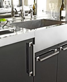 Like the chunky hardware pulls  the nickel-silver countertop and sink