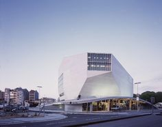 "Built by OMA in Porto, Portugal with date 2005. Images by Philippe Ruault. The past thirty years have seen frantic attempts by architects to escape the domination of the ""shoe-box"" concert hal..."