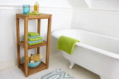 Contain bathroom clutter with a three-tiered stand. This stand-alone piece provides a handsome platform for toiletries